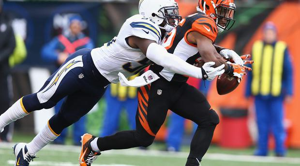 Gio Bernard of the Cincinnati Bengals with Tourek Williams of the San Diego Chargers