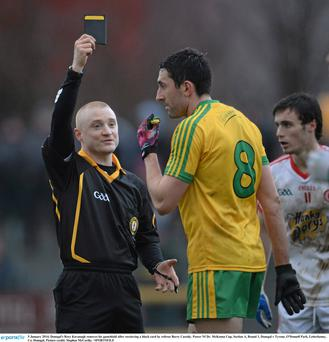 Donegal's Rory Kavanagh removes his gumshield after receieving a black card by referee Barry Cassidy. Power NI Dr. McKenna Cup, Section A, Round 1, Donegal v Tyrone