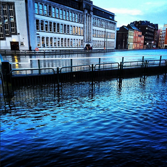 The River Lee floods South Terrace and Georges Quay in Cork city this morning. Photo: Instagram/ @ronankirby