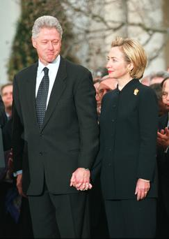 "President Bill Clinton looks toward wife Hillary before addressing the American people following a vote for his impeachment December 19, 1998 at the White House. Clinton ignored calls for his resignation in the face of impeachment , vowing to remain in office ""until the last hour of my last day of my term.'''"