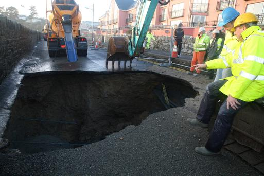 A huge hole at Tramore, Co.Waterford where the road was eroded away by the sea on Sunday. Photo; Mary Browne