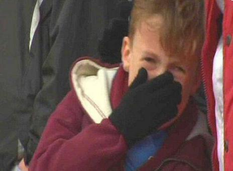A young West Ham fans is pictured in tears during the club's 5-0 FA Cup defeat to Nottingham Forest