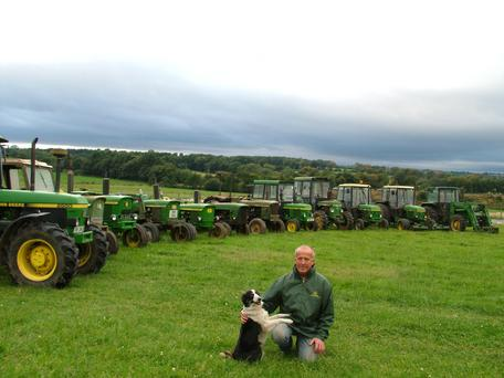 Ned Furlong is pictured with his John Deere tractor collection and Gem, the sheepdog