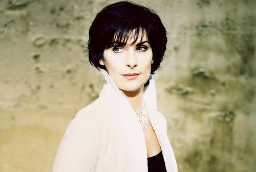 Singer Enya is sitting pretty