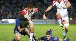 Paddy Jackson, Ulster, is tackled by Jordi Murphy, Leinster
