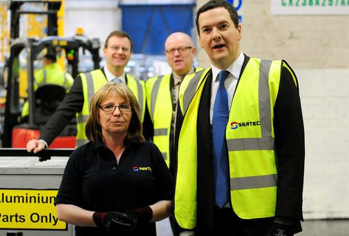 Chancellor George Osborne meets team leader Shirley Cartwright during a visit to manufacturing company Sertec, Coleshill in Birmingham, where he also gave a speech on the economy.