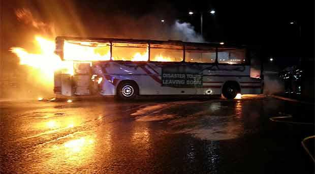 The burning bus close to the HQ of the former Quinn group