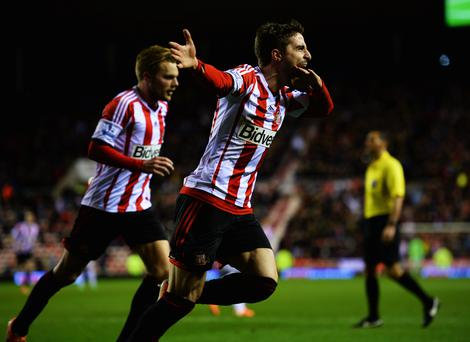 Fabio Borini of Sunderland (R) celebrates with Sebastian Larsson (L) as he scores their second goal from the penalty spot during the Capital One Cup Semi-Final