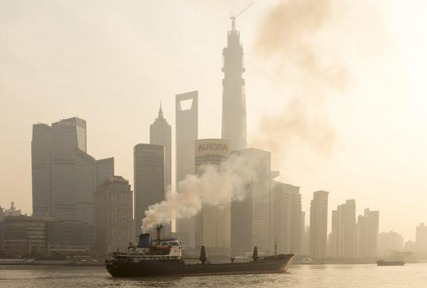 A ship sails up the Huangpu River as heavy smog engulfs the city in Shanghai, China.