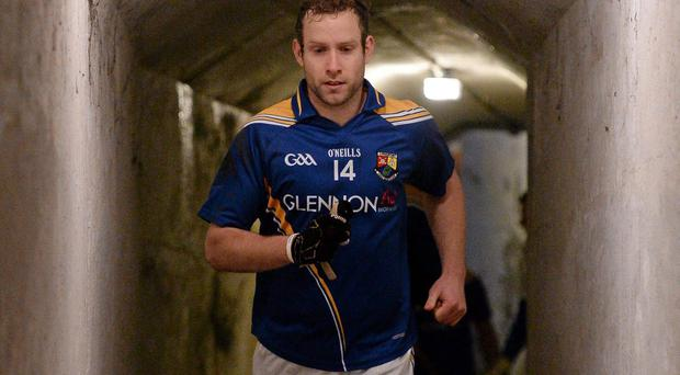 Brian Kavanagh leads his team-mates out the tunnel at Dr. Cullen Park on Sunday