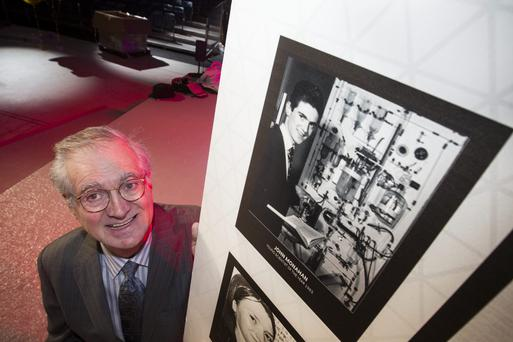 John Monahan looks at a photograph taken of him when he first won the BT Young Scientist and Technology exhibition pictured in the RDS Dublin. Picture: Mark Condren