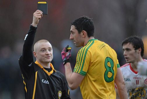 Donegal's Rory Kavanagh receives a black card by referee Barry Cassidy