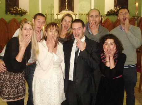 Newlyweds Karen Simmons and Gearoid Dunne (centre) surrounded by their surprised Christening/wedding guests. NewspixIrl