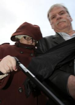 McGlinchey (left) leaves Belfast Laganside Court with her husband Gerry. Photo: Paul Faith/PA Wire