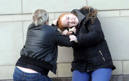 Two women exchange blows at Laganside court in Belfast following a disagreement. Court staff split the pair apart and then policing and ambulance where called to the scene Pic Pacemaker