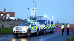 A Police road block at Salthouse in Norfolk following a helicopter crash near Cley-next-the-Sea. An investigation has begun after four crew members died when the US military helicopter crashed in Norfolk on a training mission. PRESS ASSOCIATION Photo. Issue date: Wednesday January 8, 2014. The Pave Hawk from RAF Lakenheath was taking part in a low-flying training exercise when it came down in a nature reserve in Cley-next-the-Sea around 7pm yesterday. See PA story ACCIDENT Helicopter. Photo credit should read: Chris Radburn/PA Wire
