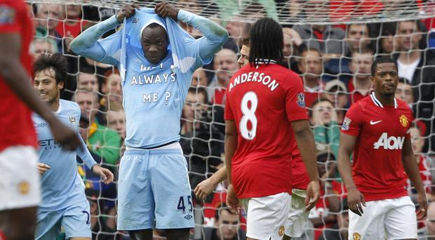Manchester City's Mario Balotelli celebrates after scoring the opening goal against Manchester United during their English Premier League soccer match at Old Trafford in October, 2011.