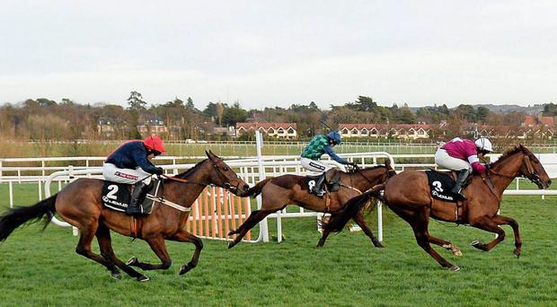 Bobs Worth, with Barry Geraghty up, left, goes past second place First Lieutenant, with David Casey, right, and third place Rubi Ball with Ruby Walsh, centre