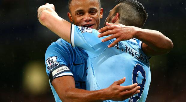 Alvaro Negredo is congratulated by Vincent Kompany after scoring his second GETTY