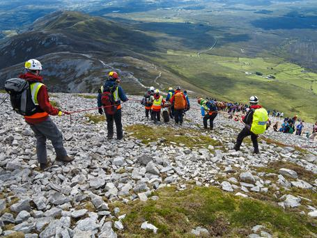 July - The team climb Croagh Patrick