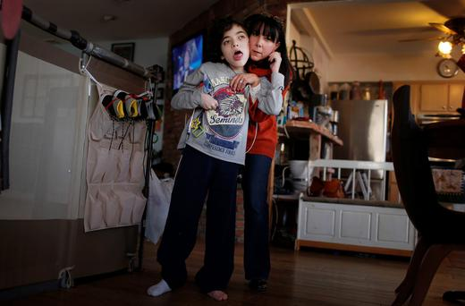 Missy Miller with her epileptic son Oliver in their home at Atlantic Beach, New York. Oliver, 14, has hundreds of seizures a day. For months, his family has pinned their hopes on a strain of marijuana developed in Colorado that has helped children with similar conditions. But under an executive order by Governor Andrew Cuomo yesterday making New York the 21st state to allow medical marijuana, it will remain illegal to grow marijuana or to import specialized plants from other states. Photo: REUTERS/Mike Segar