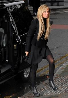 LONDON, UNITED KINGDOM - JANUARY 09: Tulisa Contostavlos arrives at court as she faces drugs charges at Southwark Crown Court on January 9, 2014 in London, England. (Photo by Stuart C. Wilson/Getty Images)
