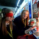 Siobhan Moore, 16, left, and Clare Lawlor, 16, from St Dominic's Secondary School, Dublin, with their project 'Illusions Uncovered'