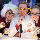 Rte 2fm's Ryan Tubridy pictured with students Roisin O Sullivan, age 11 (Left) and Rachel Whent age 11(Right) both from Kilmeen National School in Clonakilty when he broadcast his popular morning show from The BT Young Scientist & Technology Exhibition 2014 at The Rds Dublin.