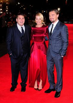 Jonah Hill (left), Margot Robbie (centre) and Leonardo DiCaprio (right) attending The Wolf of Wall Street UK premiere at the Odeon Leicester Square, London. . Ian West/PA Wire
