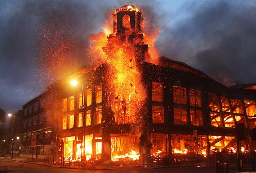 Fire raging through a building in Tottenham, north London, as trouble flared after Mark Duggan was shot dead by police