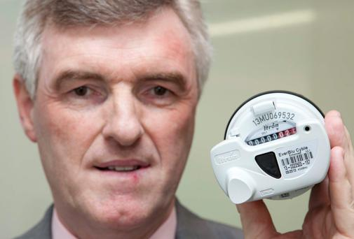 John Tierney, managing director of Irish Water, with one of the water meters being installed around the country.