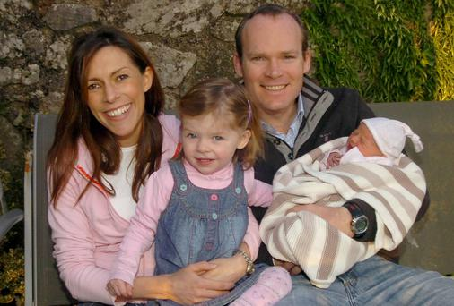 Simon Coveney with his wife Ruth and daughters Beth and three day old Jennifer at home in Carrigaline, Co Cork. Picture: Richard Mills