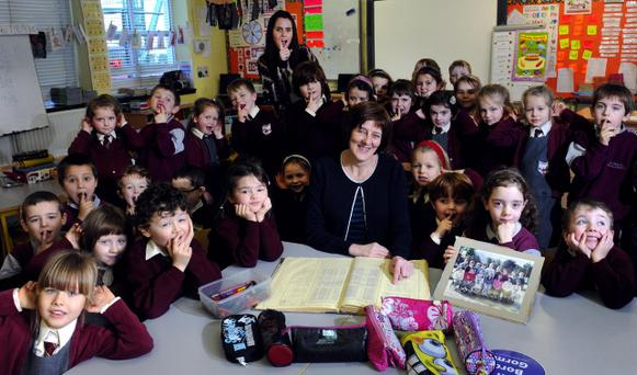 Deputy school principal Linda O'Donoghue, centre, and her pupils with the roll book at Fossa, Kerry. Picture by Don MacMonagle