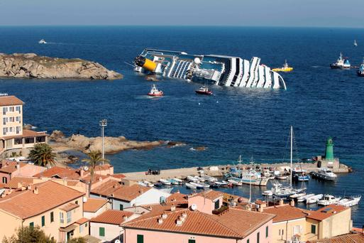 Luxury cruise ship Costa Concordia leaning on its starboard side after running aground on the tiny Tuscan island of Giglio, Italy