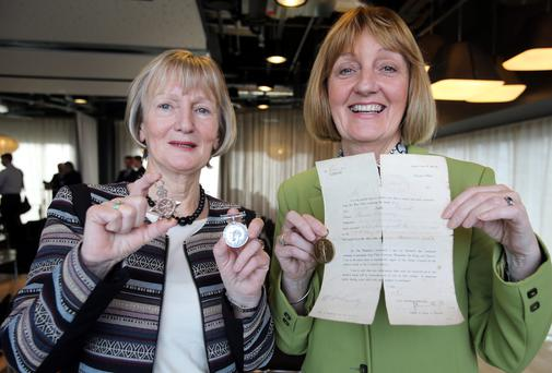 Claire Connaughton, left, and Sheila Mooney with grand-uncle Thomas Connolly's service medals and the 1917 telegram of his death. Photo: Frank Mc Grath