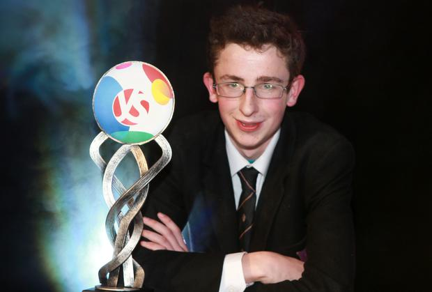 BT Young Scientist winner Paul Clarke with his trophy. Photo: Arthur Carron/Collins