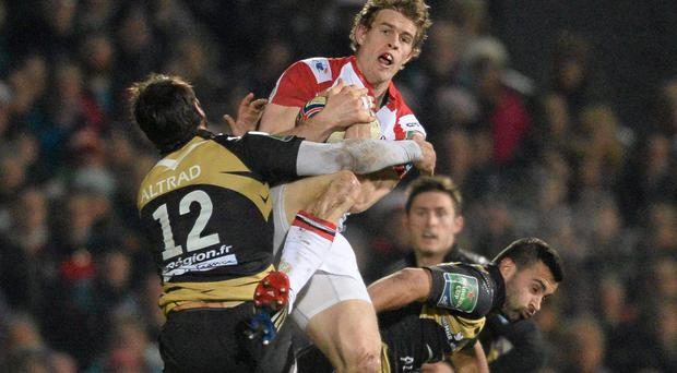 Andrew Trimble, Ulster, is tackled by Thomas Combezou and Alexandre Bias, right, Montpellier