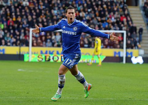 Chelsea's Eden Hazard celebrates scoring his goal against Hull City during their English Premier League soccer match at The KC Stadium