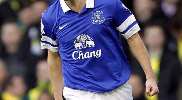 Everton's Gareth Barry celebrates scoring his side's first goal of the game during the Barclays Premier League match at Goodison Park
