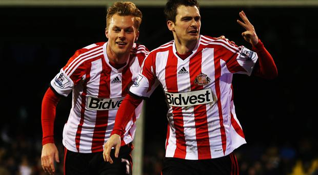 Adam Johnson (R) of Sunderland celebrates with team mate Sebastian Larsson (L) after scoring a hat trick