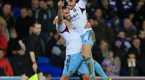 West Ham United's Mark Noble celebrates scoring the secondnd goal with Andy Carroll