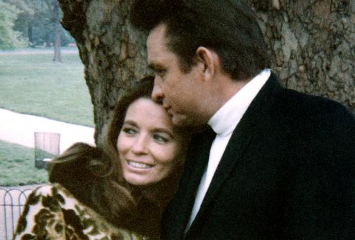 CROSSING THE LINE: Johnny Cash, with his second wife June Carter. Cash was involved with Carter during his first marriage, but later had an affair with her sister. Photo: The Bill Miller Collection