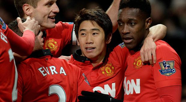 Manchester United's Danny Welbeck (right) celebrates with Shinji Kagawa and Nemanja Vidic after scoring during the Barclays Premier League match at Old Trafford