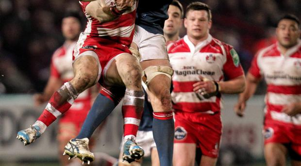 Munster's Tommy O'Donnell contends for the ball with Dan Robson, Gloucester. Photo: Matt Impey / SPORTSFILE