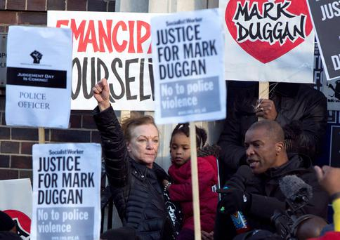 Carole Duggan gestures during a vigil for her nephew Mark Duggan, outside Tottenham Police Station in Tottenham. Mark Duggan, 29, died after he was shot by police who suspected he was armed at the time. Photo: REUTERS/Neil Hall
