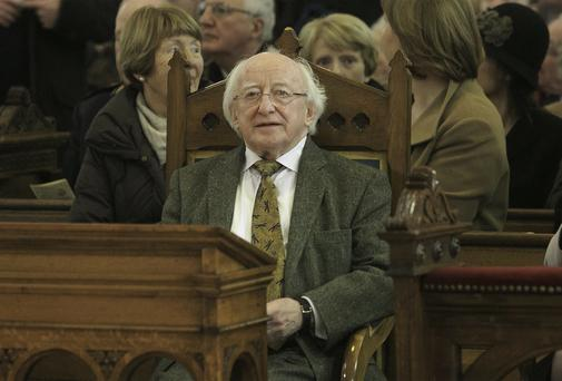 TIME TO REFLECT: President Michael D Higgins at Mass in the Pro-Cathedral, Dublin. Photo: Gareth Chaney, Collins