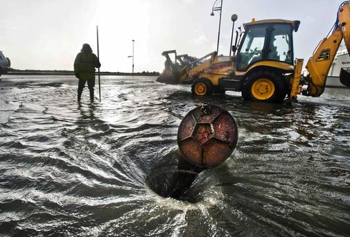 Martin Folan from Galway City Council looks on as flood waters begin to drain away. Photo: Declan Monaghan