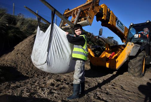 Local volunteer, 9 year old Darragh Brett helps out with repairs to the eroded sand dunes at The Burrow, Portrane.