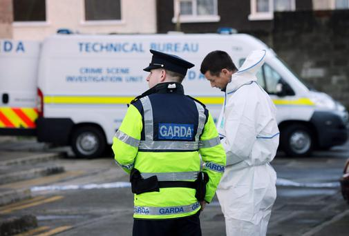 Gardai and forensic at the scene of the discovery of a man's body at Spring Mount Appartments on Wellmount Road, Finglas yesterday. Photo: Tony Gavin