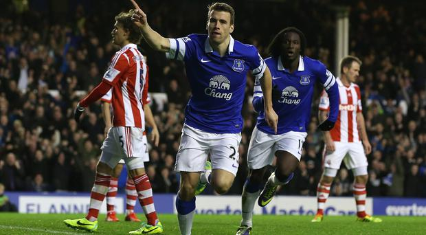 Seamus Coleman of Everton celebrates his goal during a match between Everton and Stoke City